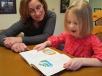 Lilah practices reading with fluency and expression.